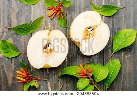Half of Asian pears fruit on wooden background