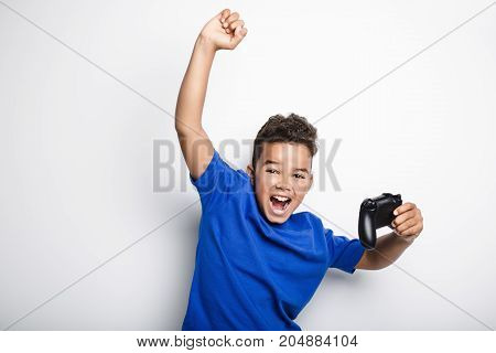 A young child having fun playing video games