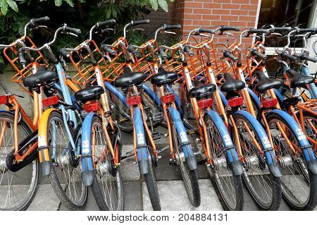 AMSTERDAM NETHERLANDS - MAY 15 2017: Parking of rental bicycles near the youth hostel