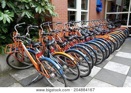 AMSTERDAM NETHERLANDS - MAY 15 2017: Parking of rental bicycles near the Stayokay youth hostel