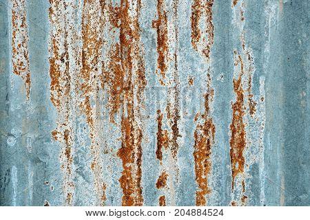 Rusty zinc metal sheet textured background, detail close up