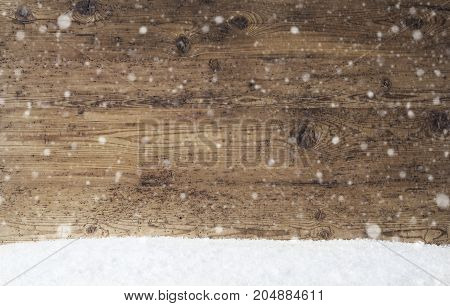 Rustic Wooden Texture With Copy Space For Advertisement. Natural Wood Background With Snow And Snowflakes
