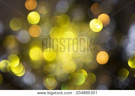 Sparkling Golden Lights Texture With Bokeh Effect. Party, Celebration Or Christmas Background.