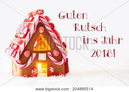 Gingerbread House In Snowy Scenery As Christmas Decoration With White Background. Candlelight For Romantic Atmosphere. German Text Guten Rutsch Ins Jahr 2018 Means Happy New Year
