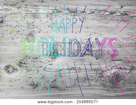 Colored English Calligraphy Happy Holidays. Gray Vintage Wooden Background