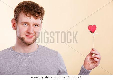 Happy Man Holding Heart.