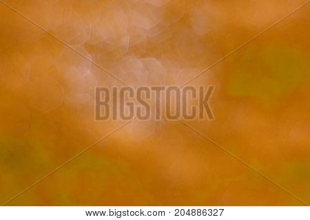 The Complex Blurred Of Orange And White Hexagonal  Background