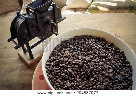 Roast coffee beans in big cub, arabica roasted coffee ,color vintage style. Thailand