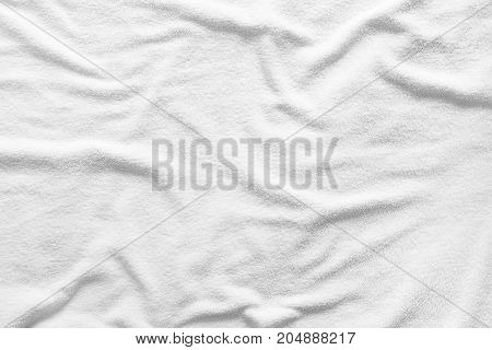 Close-up white towel texture for a background.