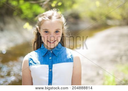 A nice cheerful teen outside in forest