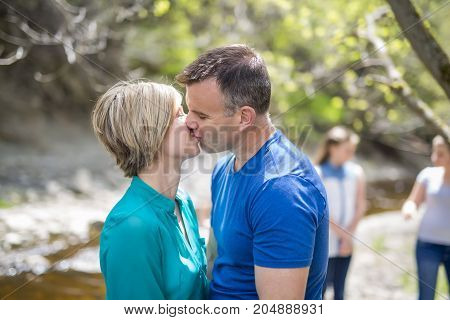 A couple in the wood giving kiss