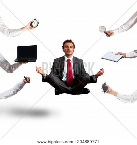Relaxed businessman that does yoga exercise during the work