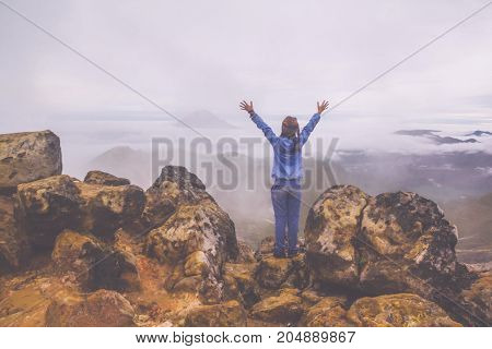 Freedom woman standing on top of Mount Sibayak, Indonesia
