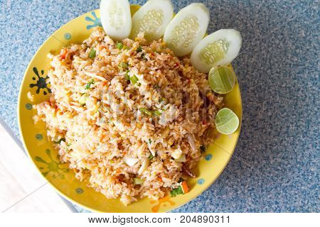 Crab fried rice with fresh cucumber and lemon