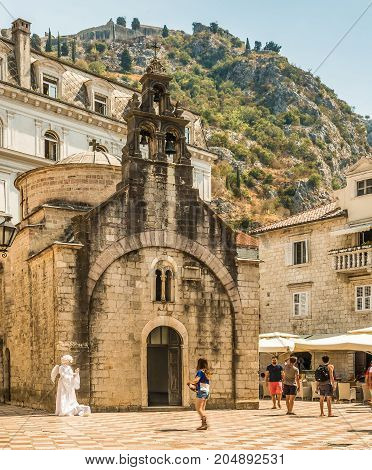 Kotor, Montenegro - August 24, 2017: Fragments of buildings and the church of St. Nicholas in the old town of Kotor, Montenegro.