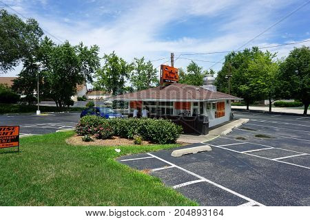 JOLIET, ILLINOIS / UNITED STATES - JULY 21, 2017:  One may drink root beer and eat sandwiches at Pierson's Ace Drive-In, on Plainfield Road.