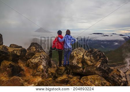 Couple standing on top of Mount Sibayak, Indonesia