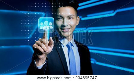 businessman touch hr icon on blue background