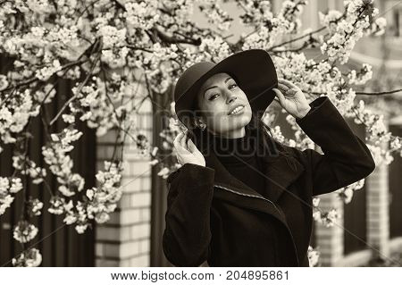 spring portrait of young woman in wide-brimmed hat