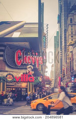 New York USA - September 28 2016: Busy intersection on the corner of 8th Avenue and West 42nd Street near Times Square in Manhattan.