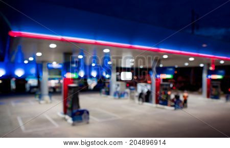 Lighting blurred in gas station at night