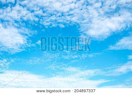 Beautiful blue sky with clouds on sunshine day with copy space for text