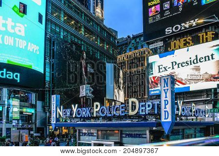 New York USA - 28 September 2016: New York Police Department Times Square Precinct against Bright Lights Billboards in Manhattan.