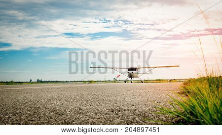 Small airplane coming on a taxiway in the morning with beautiful blue sky. Bright life. High growth and high risk business concept.