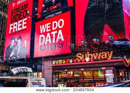 New York USA - September 2016: Large Billboards above the Times Square - 42nd Street Subway station located at the intersection of 42nd Street Seventh and Eighth Avenues and Broadway in Midtown Manhattan.