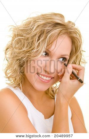 Smiling Woman Using color stick For Her Eyes