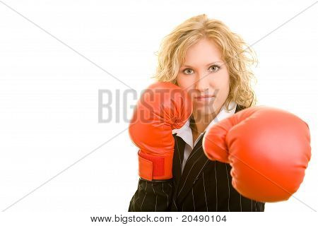 Business Woman Attacking With Boxing Gloves