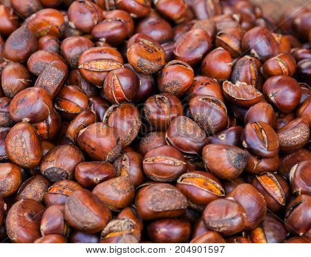 Autumn chestnuts grilled cooking background nut brown