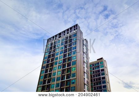 The tall building is located in the heart of Bangkok in Thailand. With beautiful views of the sky in the background and within the surrounding area.