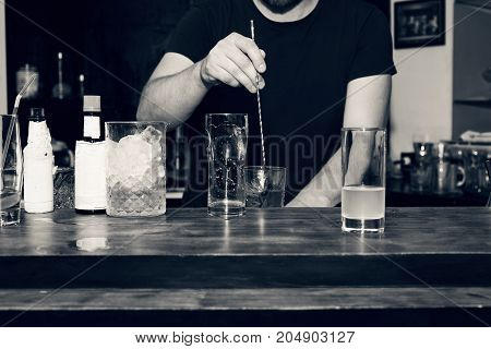 The Barman Is Preparing A Cocktail At The Bar