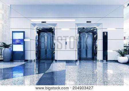 Double elevators in department store, Modern building