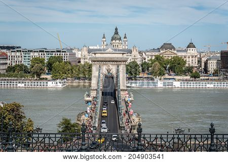 Budapest, Hungary - August 12, 2017: High angle view of Chain Bridge. It is a suspension bridge that spans the River Danube between Buda and Pest, was the first permanent bridge across the Danube.
