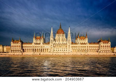 Budapest, Hungary - August 12, 2017: Scenic view at sunset of Hungarian Parliament in Budapest. It lies on the bank of the Danube.