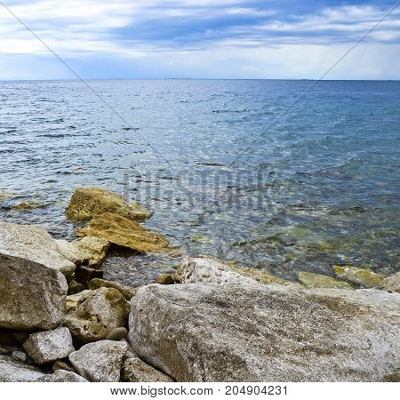Rocks at the sea in summer time