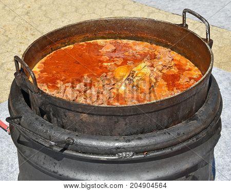 Cooking goulash outdoor in summer food in summer