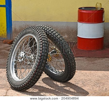 Tires of a speedway motorcycle and a fuel barrel