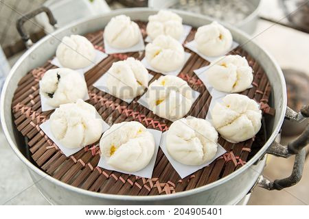 Chinese buns on pot - Stock Image