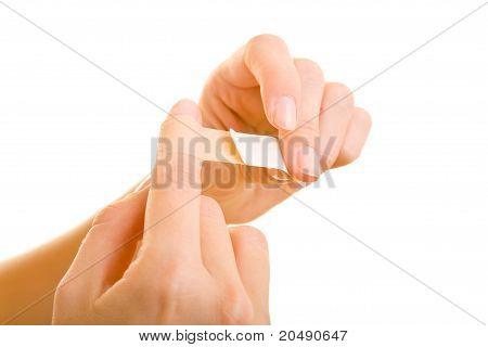 Woman Pulling Off A Bandaid