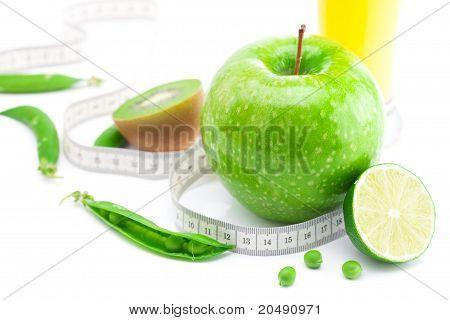 Juice,apple,lime,peas,kiwi And Measure Tape Isolated On White