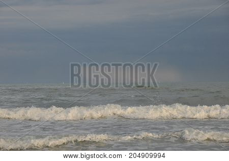 Adriatic Sea Italy. Waves crashing against the shore against a stormy sky.