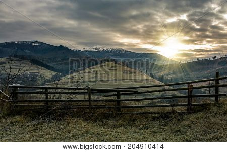 Fence On Hillside In Late Autumn Gloomy Sunrise