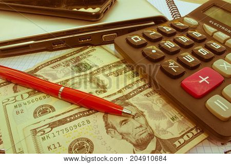 Calculator and money thai banknote on wooden table. The concept of financial planning savings. Business Objects in the office on the table - Retro color