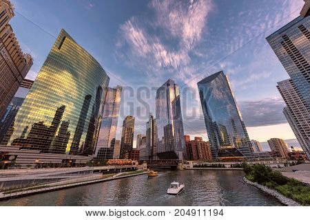 Chicago downtown and Chicago River with bridges during sunset.