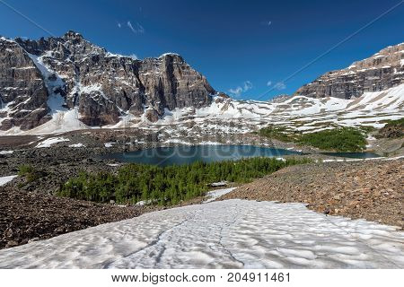 Beautiful Eiffel Lake with snow-covered Canadian Rockies, trail from Moraine lake, Canada.