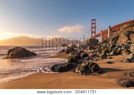 San Francisco beach and Golden Gate Bridge at sunset, California, USA