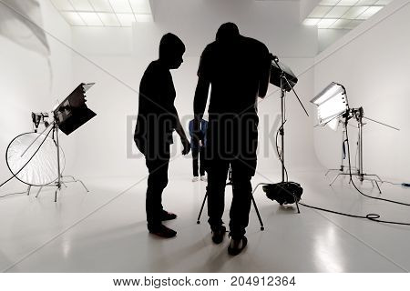 On the set in the studio. silhouette of people working in video studios